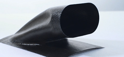 A hollow composite duct made with FDM sacrificial composite tooling.