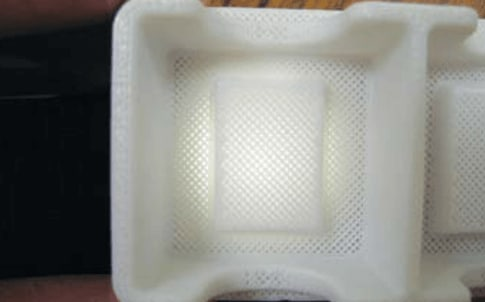 Xerox experimented with various levels of porosity in its thermoforming molds, as shown in this trial  fixture.